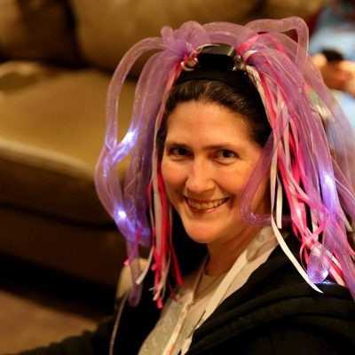 Penguicon-goer with pink light up wig