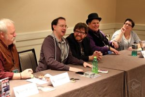 5 panelists at a long table