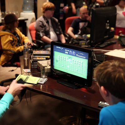 People playing retro video games