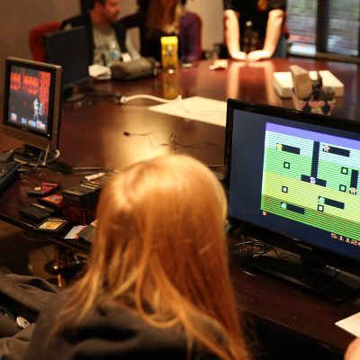 Person playing a retro video game