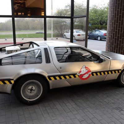 Silver car with Ghostbusters logo