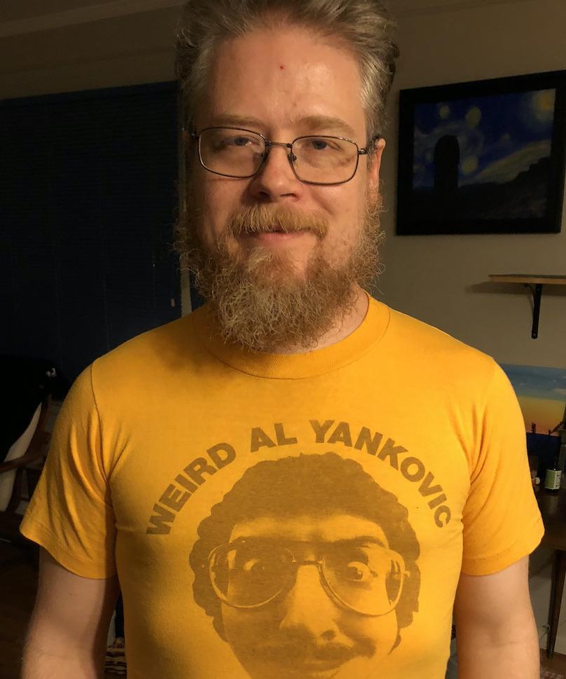 Man with old school weird al shirt